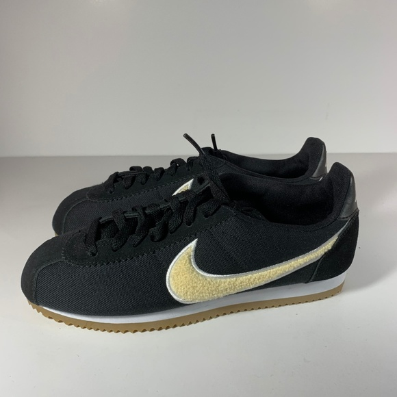 super popular c28d6 41e46 Nike Classic Cortez Black Gold Chenille Swoosh
